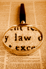law-and-magnifying-glass on employee screening blog